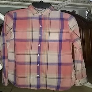 A striped,multi colored,button up,long sleeve tee